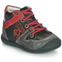 Schuhe Jungen Boots Catimini COMATULE Schwarz / Rot